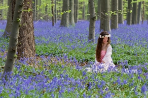 Innocent young woman with pink fairy dress in a springtime blueb