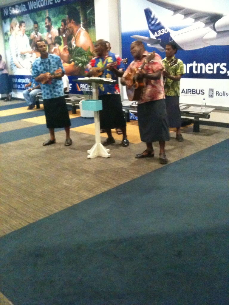 Being serenaded on arrival at the airport